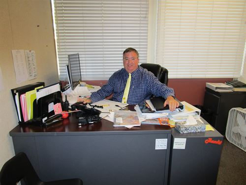 principal sitting at his desk